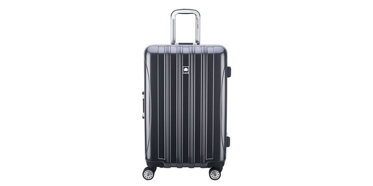 dark coloured luggage with wheels